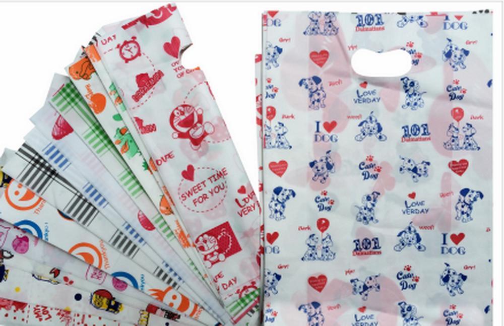 Túi xốp đóng gói hàng in sẵn hoa văn, họa tiết ( 1kg túi , màu hoặc hình ngẫu nhiên )