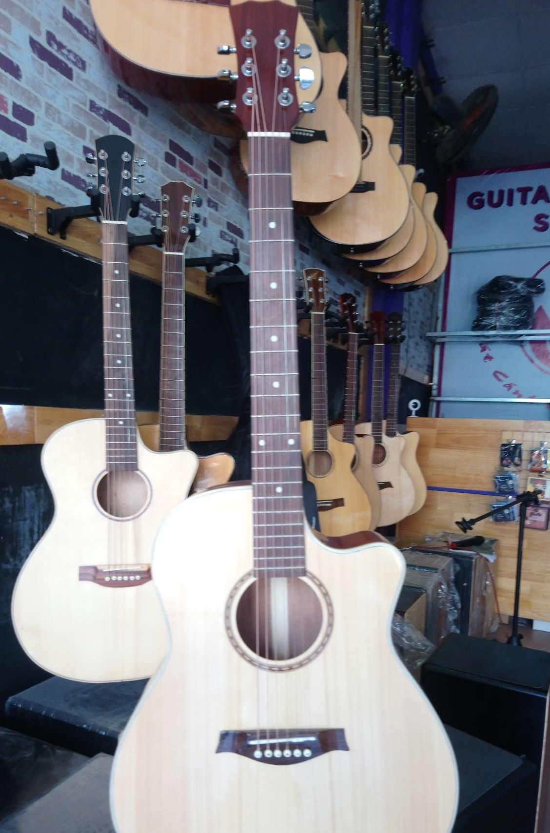 Guitar gỗ nguyên tấm có ty