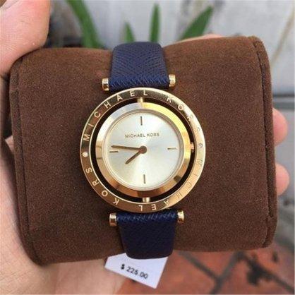 Đồng hồ nữ dây da MK2526 xoay mặt trắng (dây xanh) bán chạy