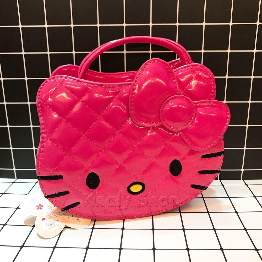 Giá bán Túi xách tay , đeo chéo mèo Kitty da bóng đan chéo màu hồng đậm 80-HD1138B (16x9x20cm)