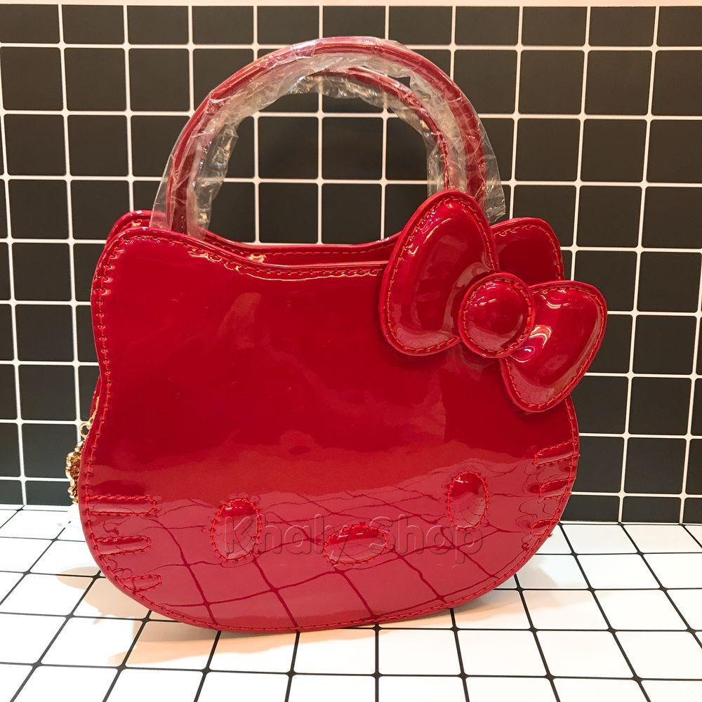 Giá bán Túi xách tay , đeo chéo mèo Kitty da bóng trơn màu đỏ 90-DO1138 (16x9x20cm)