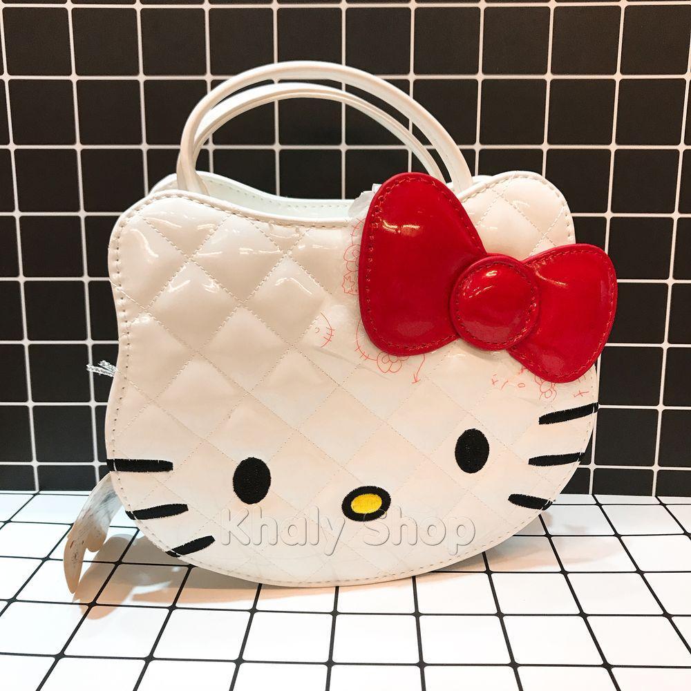 Giá bán Túi xách tay , đeo chéo mèo Kitty da bóng đan chéo màu trắng 80-TND1138B (16x9x20cm)