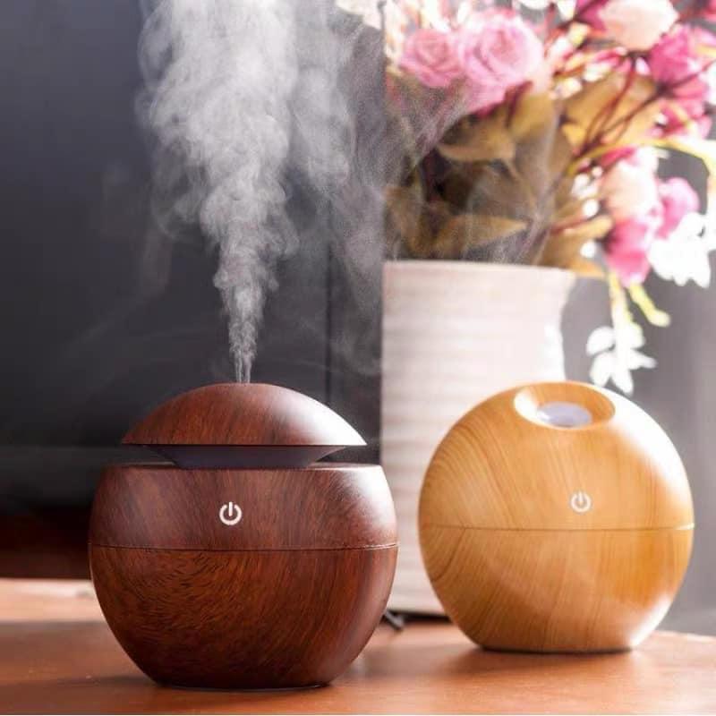 Máy phun sương, máy xông tinh dầu , máy khuếch tán tạo độ ẩm khuếch tán tinh dầu vân gỗ dung tích 130ml hình tròn có đèn led